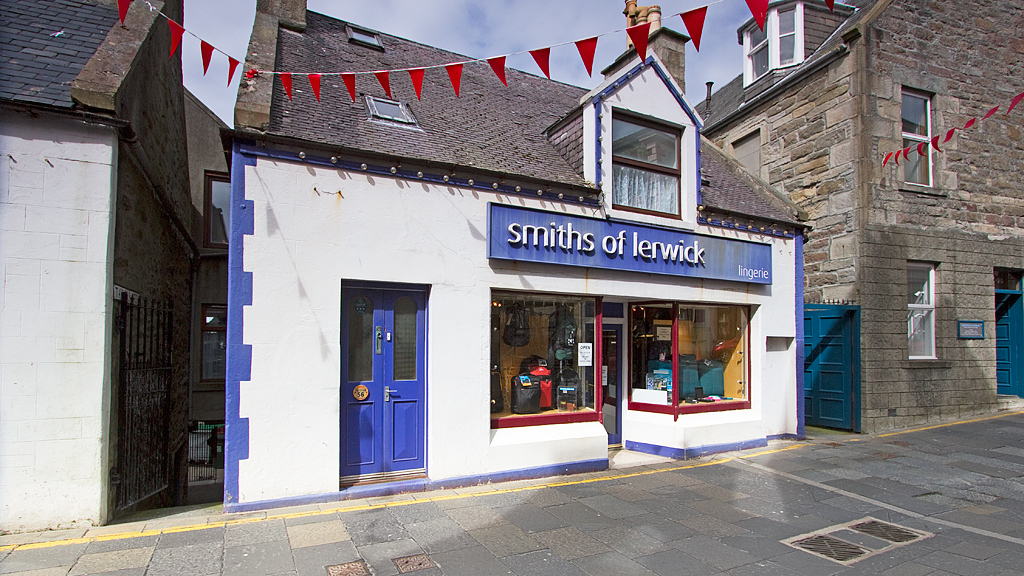 Apartment is located above Smiths of Lerwick bag shop, entry via purple door on left